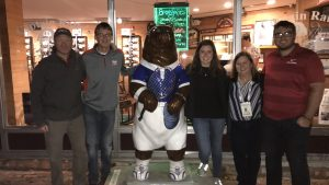 Dr. Chandra Clark with students and faculty from The University of Alabama and the University of Oklahoma standing with a bear statue.