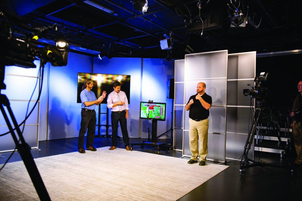Three men in TV studio