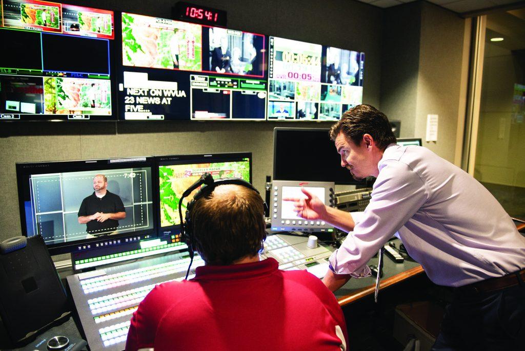 Two men editing video