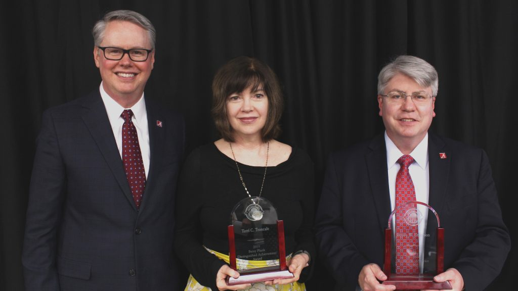 Dean Mark Nelson with Terri Truncale, the 2019 Plank Award Winner, and Jeffrey Emerson, the 2019 Bank Award Winner, at Honors Day 2019.
