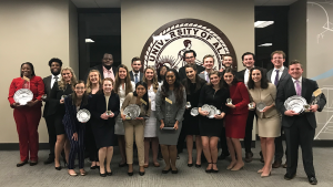 The Alabama Forensic Council celebrates a fourth-place finish at the AFA-NIET in Tuscaloosa.
