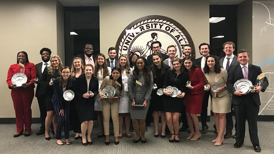 The Alabama Forensic Council celebrates a fourth-place finish at the AFA-NIET in Tuscaloosa.