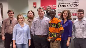 APR News Director Pat Duggins and Malian reporter Ousmane Sagara with members of the APR staff.