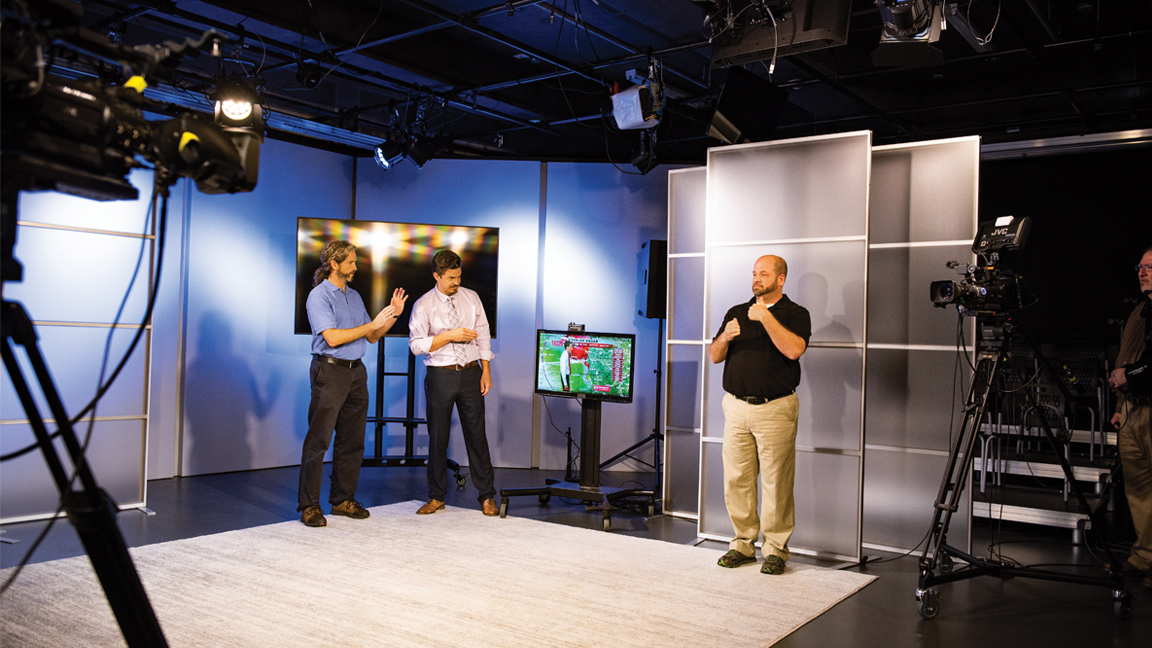 Jason Senkbeil (left) and Darrin Griffin work with Alabama Institute for Deaf and Blind Interpreter Gary Crook to prototype test their American Sign Language interpreting system.